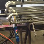 Enclosed Orbital Welding Head on Stainless Pipes