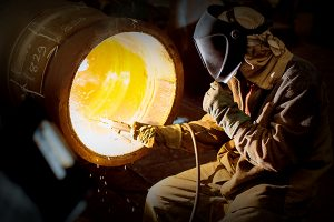welder working on a pipe
