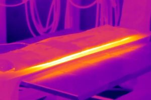 steel plate being heated with induction heating
